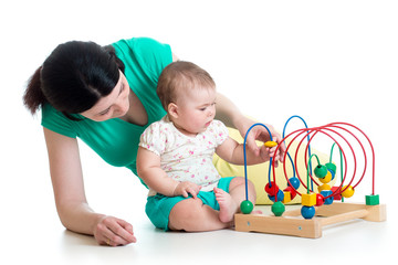 child and mother play with color educational toy