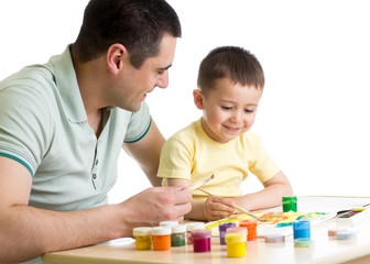 kid boy and dad paint together isolated on white