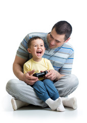child boy and his father play with a playstation together