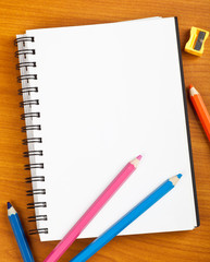 Notepad with kids stationery on a table