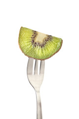 Slice of kiwifruit held by a fork isolated on white background
