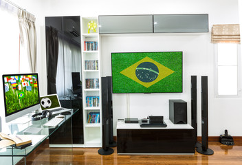 Modern office with computer and laptop watch for Soccer champion