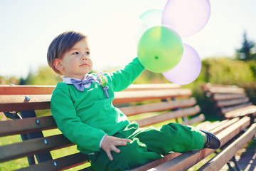 Portrait of a little boy with baloons