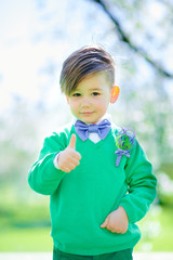 portrait of cute boy showing thumbs up.
