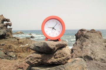 Red Clock Near the Ocean