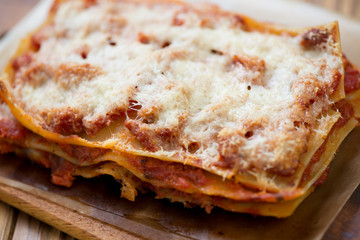 Close-up of lasagna bolognese, horizontal shot