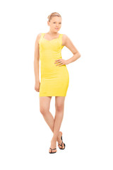 Fashion model posing in a yellow dress