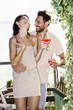 couple in love having spritz time with lake view in summer