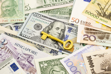 golden key  and world currency money banknotes