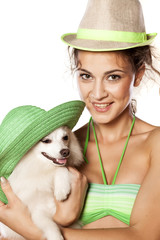 nice girl and little dog posing with hats