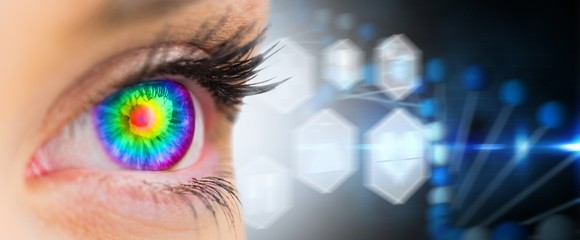 Composite image of psychedelic eye looking ahead on female face
