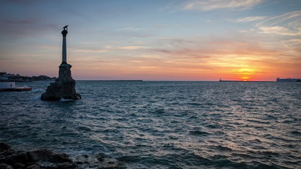 Sea at sunset and a monument (Monument to the Scuttled Ships) in