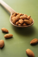 Bitter almonds on a wooden spoon