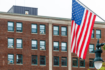 American Flag with Old Brick Building in Background