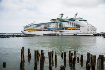 Luxury Cruise Ship Beyond Wood Pilings
