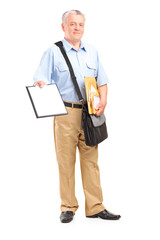 Mailman holding clipboard and bunch of envelopes