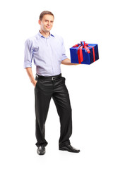 Guy holding a big present