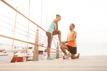 Young attractive mixed race couple sharing a morning of exercise