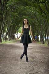 Lady in black dress in summer park