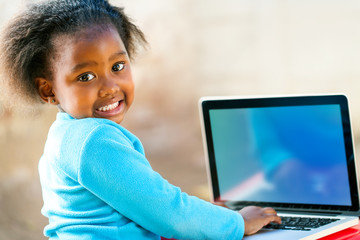 Afican child learning on computer