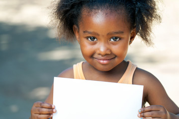 African girl holding white card.