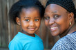African mother and young girl.