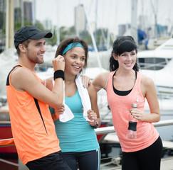 Three friends enjoying morning exercises together