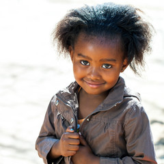 Little african girl outdoors.