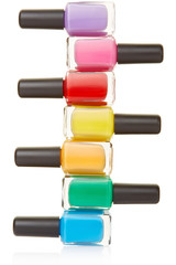 Nail polish bottles colorful stack on white, clipping path