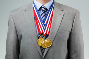 Succesful businessman with gold medals
