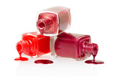 Red nail polish spilled on white background, clipping path