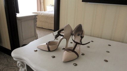 beautiful bridal shoes are on the table