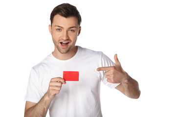 Happy man showing by finger on blank card