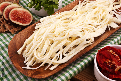 String Cheese On Chopping Board - 66476261