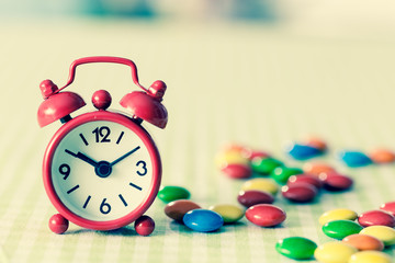 Alarm Clock and candy on the table .instagram photo