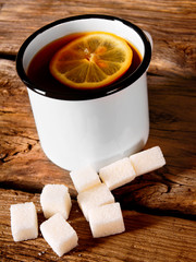 Black tea with lemon and sugar.