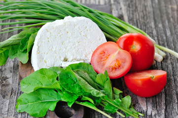 Cheese with tomatoes and arugula and onion