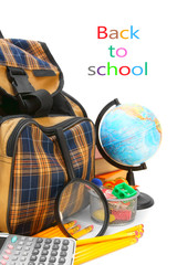School bag, a magnifier, the globe and other school accessories