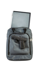 Gun and Notebook computer with carry bag on white background