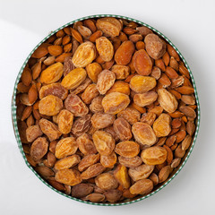 Dried apricots. Stone from apricot on a white backgrou