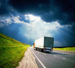 trucks under colorful sky