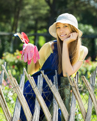 Smiling female gardener in uniform