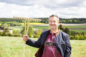 Farmer standing in his field