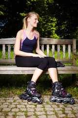 Pretty roller skates lady relaxing