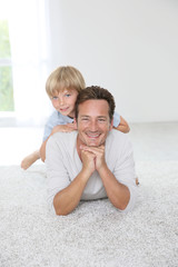 Portrait of cheerful man with 7-year-old son