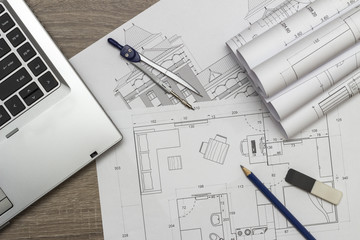 Architecture blueprints and laptop