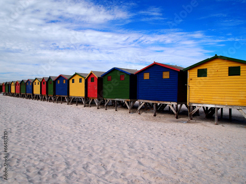 Row of wooden brightly colored huts - 66483210