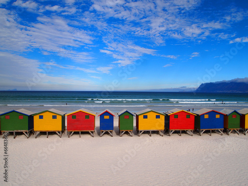 Row of wooden brightly colored huts - 66483683