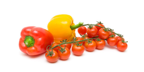 cherry tomatoes and sweet peppers isolated on white background