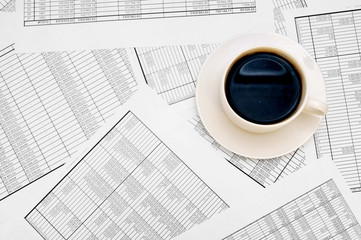 Cup from coffee on documents.